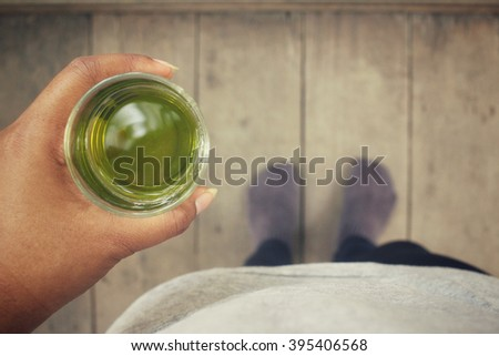 Selfie of green tea with shoes - stock photo