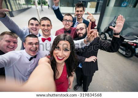 Selfie of the sucessful elegant business team. Selective focus, shallow depth of field. - stock photo
