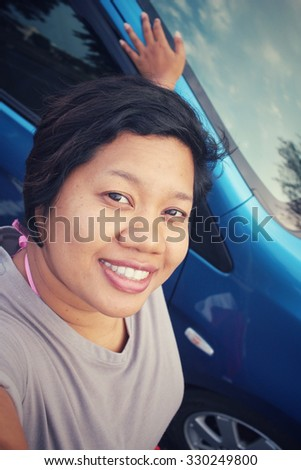 Selfie of woman with car