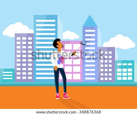 Selfie on smartphone using monopod. Young man taking own self portrait with mobile phone and stick on background with city town. Man standing on the street and photographed. Raster version - stock photo