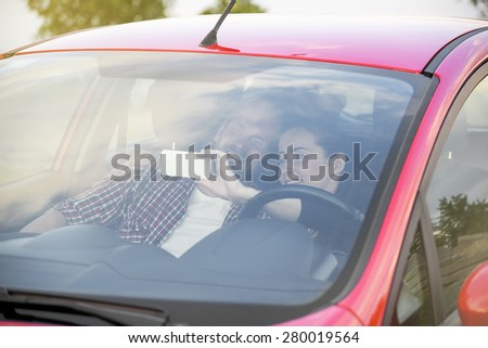 Selfie photo of young couple in red car. - stock photo