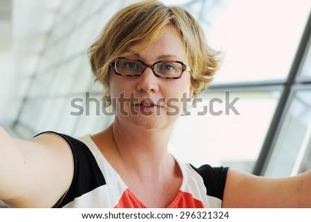 selfie portrait of beautiful 35 years old woman - stock photo
