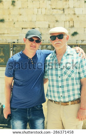 Selfie portrait of father and adult son near the Western Wall in Jerusalem - stock photo