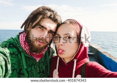 Selfie portrait of young woman and man.