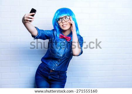 Selfie. Pretty teen girl taken pictures of her self. Beauty, fashion. - stock photo