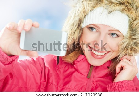 selfie,  self. happy girl in an active winter holiday pictures of herself on the phone - stock photo