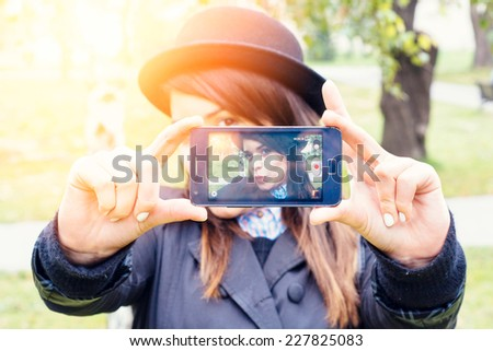 Selfie shoot of beauty female in park,selective focus