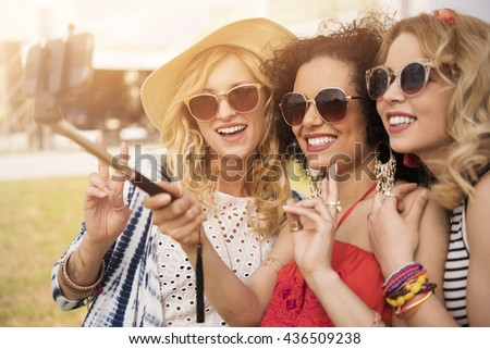 Selfie stick as a very helpful tool - stock photo