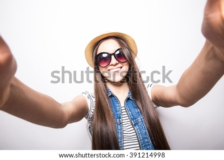 Selfie time. Joyful young women making selfie by her smart phone  - stock photo