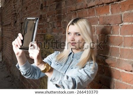 Selfie. Young blond hipster girl make self shot outdoors, copyspace. - stock photo