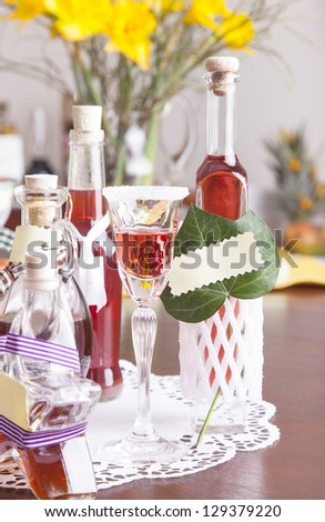 selfmade red currant and walnut liqueur - stock photo