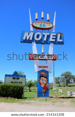 SELIGMAN, ARIZONA - AUGUST 16, 2014: Stagecoach 66 Motel sign on Historic Route 66 on August 16, 2014 in Seligman, AZ. This is the largest motel in Seligman, birthplace of route 66.