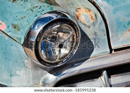 SELIGMAN, ARIZONA/USA - JULY 31 : Headlamp on abandoned car in Seligman on Route 66 Arizona on July 31, 2011 - stock photo