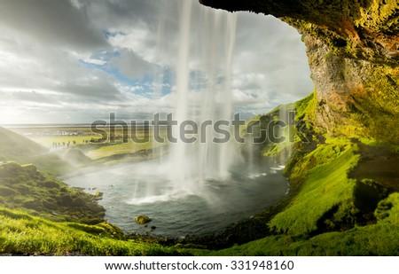 Seljalandfoss waterfall at sunset  - stock photo