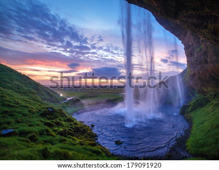 Seljalandfoss waterfall at sunset, Iceland. Horizontal shot. - stock photo