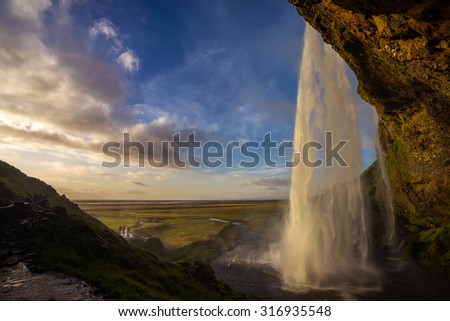 Seljalandsfoss waterfalls during sunset in Iceland - stock photo
