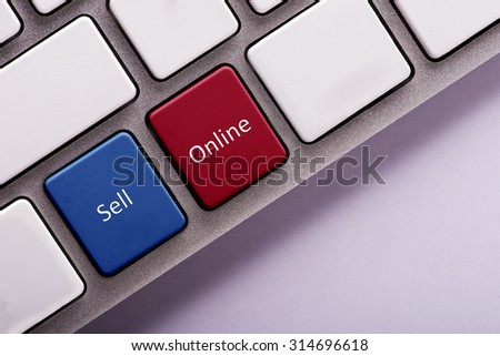 Sell Online button on white computer keyboard - stock photo