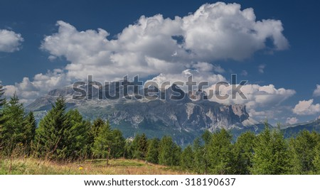 Sella mountain Group and Sassongher mountain peak as seen from Piz La Ila and La Frainas mountain plateau meadows, La Villa, Val Badia, Alta Badia, Dolomites, Trentino, Alto-Adige, South Tyro, Italy