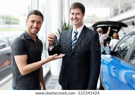 Seller gives the buyer of the car keys