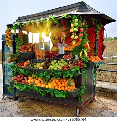 Selling fresh fruits and vegetables on the streets of Acre in Israel at morning - stock photo