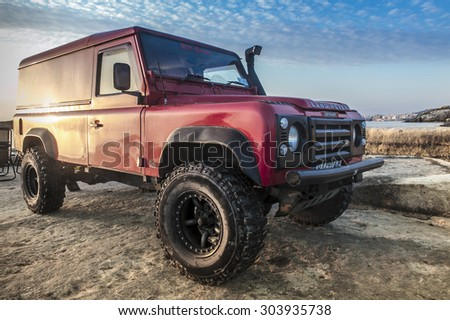SELMUN, MALTA - MAY 31, 2015: A 1989 Land Rover Defender 110. The iconic Defender sadly goes out of production production in December 2015. - stock photo