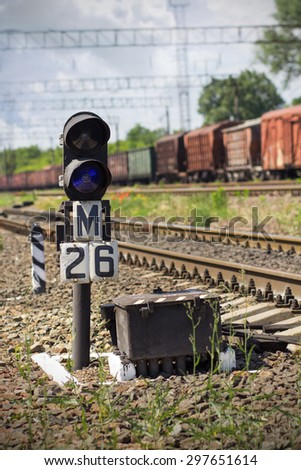 Semaphore from railway lines and train - stock photo