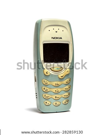 SEMBAWANG, SINGAPORE - MAY 9, 2015: Nokia 3315 cell phone isolated on white background. Nokia is a Finnish communications and information technology corporation. - stock photo