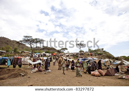 SEMBETE, ETHIOPIA - JULY 31: Sembete Market, a local market attended by a variety of ethnic groups such as Afar, Oromo and Amara, to sell camels, salt and jewelry. July 31, 2011 in Sembete, Ethiopia - stock photo