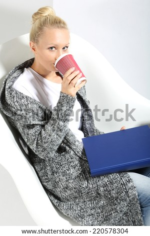 Semester exam.  Science exam, a woman with a cup of coffee reading notes  - stock photo
