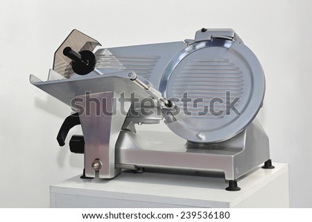 Semi Automatic meat and ham slicer machine - stock photo