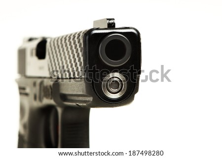semi-automatic pistol focused on gun barrel , white background - stock photo