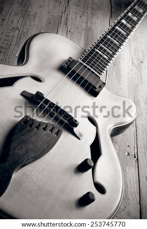 semi hollow jazz guitar on aged wood, vintage style photo - stock photo