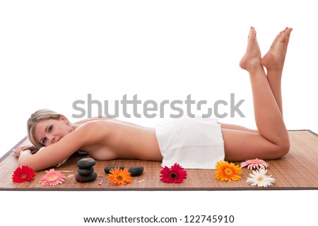Semi nude women  taking  stone therapy at spa. - stock photo
