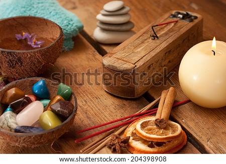 Semi precious stones and aromatic sticks set up. - stock photo