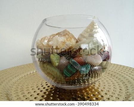 Semi Precious Stones in a Glass Decorative Bowl - stock photo