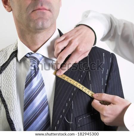 Semi-ready, elegant tailor made suit - stock photo