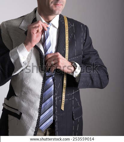 Semi-ready, elegant tailor made suit and man - stock photo