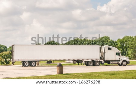 Semi truck at a rest area on Interstate I-55 , on June 10, 2013. The freight volume in the United States expected to grow by more than 80 percent in the next 20 years, says news report - stock photo