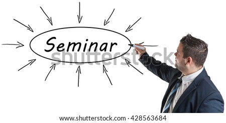 Seminar - young businessman drawing information concept on whiteboard.