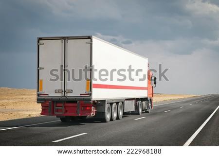 semitruck on the desert road - stock photo
