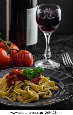 Semolina pasta with spicy tomato salsa, garlic and basil,  - stock photo