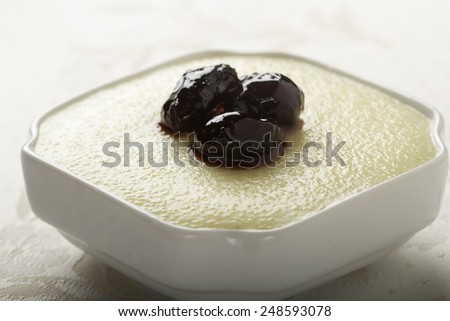 Semolina with milk and honey in white bowl - stock photo