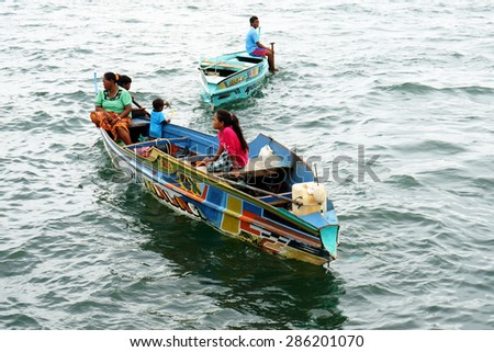 SEMPORNA, MALAYSIA - MARCH 5 : A group of local sea gypsy kids at their boat March 5. 2015 in Semporna, Sabah, Malaysia. Children live here do not attend school for lack of means and resources.  - stock photo