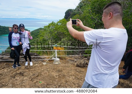 Semporna,Sabah-Sep 10,2016:Tourist taking photos from viewpoint National Park on top of Bohey Dulang island Semporna,SabahBorneo.Bohey Dulang Island is the one most popular island among tourists.
