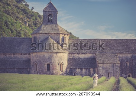 Senanque Abbey with holiday girl wearing hat - stock photo