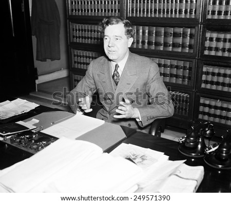 Senator Huey Long at the Capitol. Jan. 1935. He proposed wealth redistribution by taxing the assets of corporations and wealthy individuals to end poverty. - stock photo