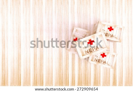 send emergency aid to Nepal.Nepal earthquake.Wooden crate on wood floor and have a background of the sea. - stock photo