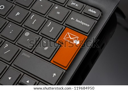 Send Return Key symbolizing sending a finshed message by email to a recipient via the internet - stock photo