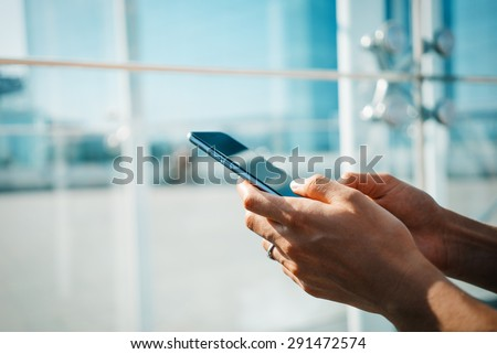 Send sms by smart phone - stock photo