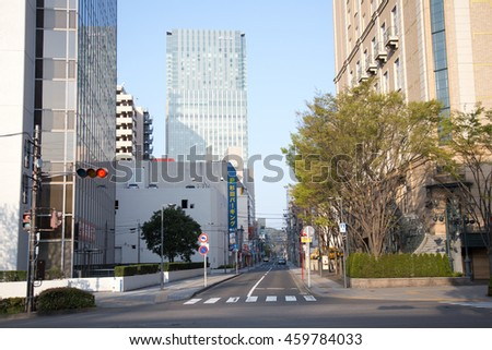 SENDAI, JAPAN - 16 APRIL 2016 : Traffic lights with building at Sendai on April 16, 2016, Sendai, Japan. Sendai is the largest city in Tohoku, north part of Japan.